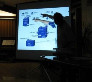 Dennis Quinn gives powerpoint presentation